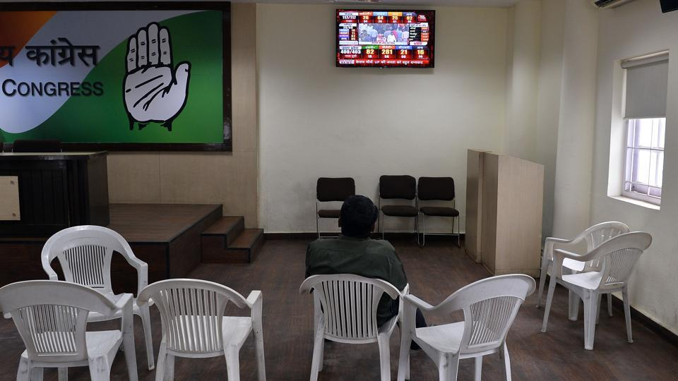 A man sits in the deserted Congress party offices as election results are announced in New Delhi on March 11.