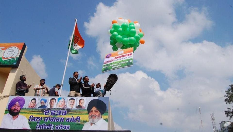 Congress workers releasing tricoloured balloons after the party's victory in Jalandhar on Saturday.