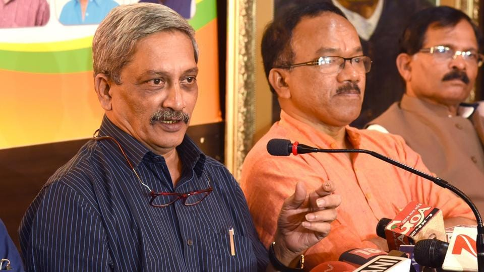 Defence minister Manohar Parrikar (in blue shirt)briefs the media in Panaji on Saturday, after results of the Goa assembly election results were declared.
