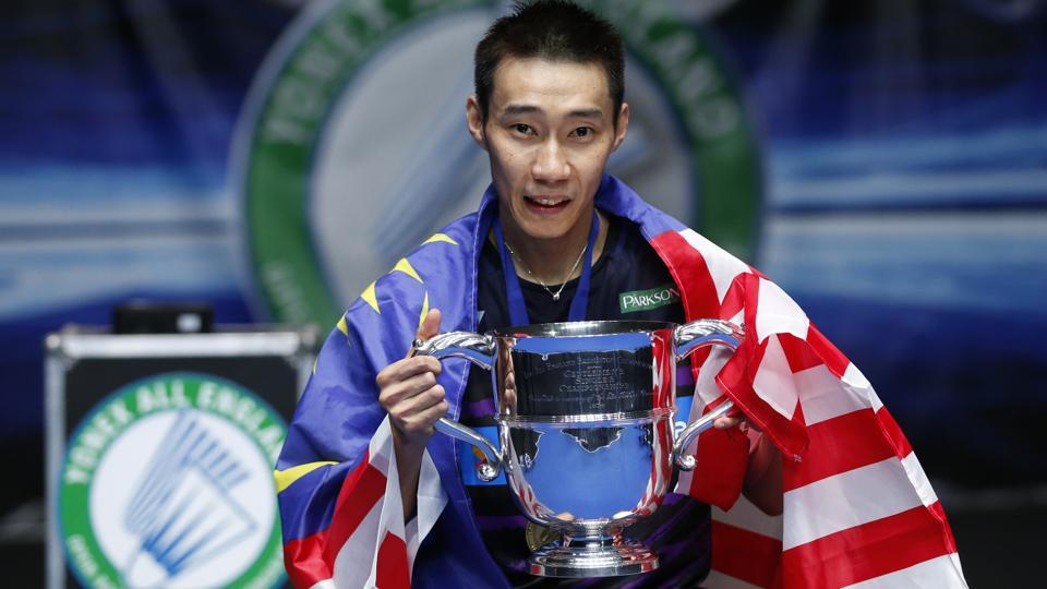 Lee Chong Wei poses with the trophy after victory in the All England Open Badminton Championships final.