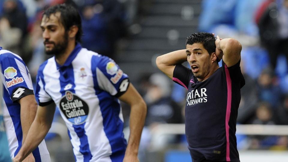 FC Barcelona's Luis Suarez, right, reacts after missing a shot during their La Liga match against Deportivo La Coruna.