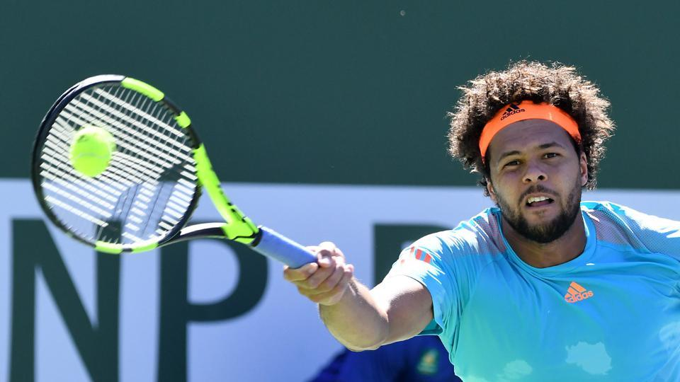 Jo-Wilfried Tsonga's nine match winning streak ended as he was dumped out in the third round of the Indian Wells tournament by Fabio Fognini.
