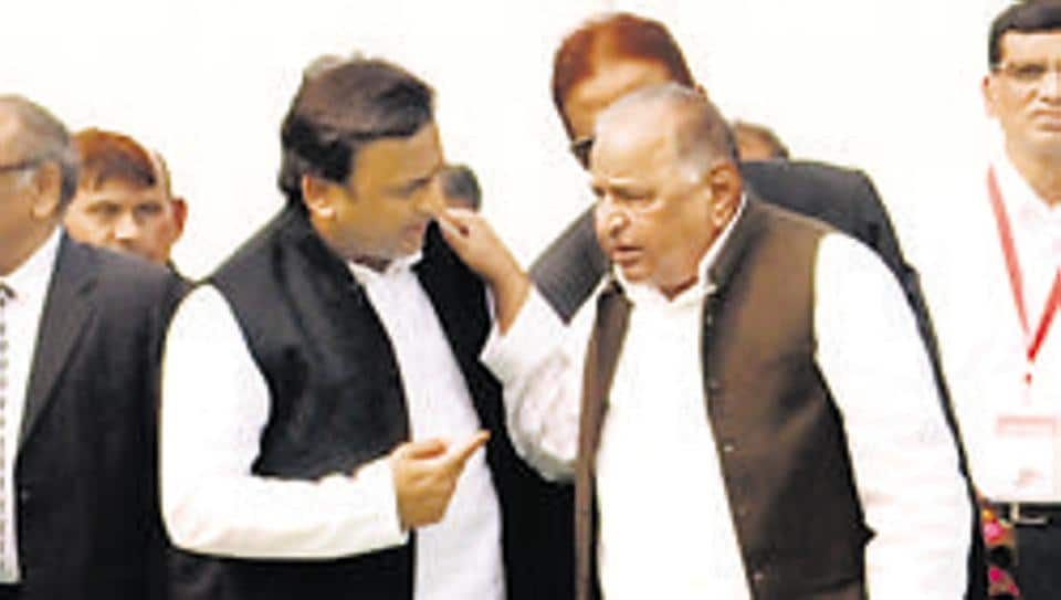 Uttar Pradesh chief minister Akhilesh Yadav with Mulayam Singh Yadav in Lucknow.