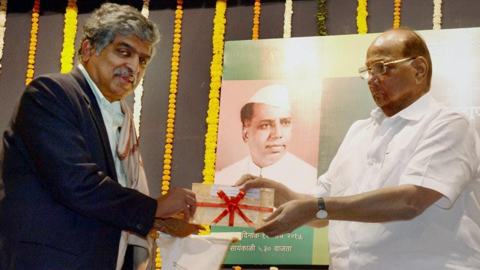 NCP president Sharad Pawar (R) presents Y B Chavan National Award (Rs 5 lakh cheque) to Nandan Nilekani, former chairman of the Unique Identification Authority of India, in the memory of Yashwantrao Chavan 104th birth celebration at YB Chavan Center in South Mumbai on Sunday.