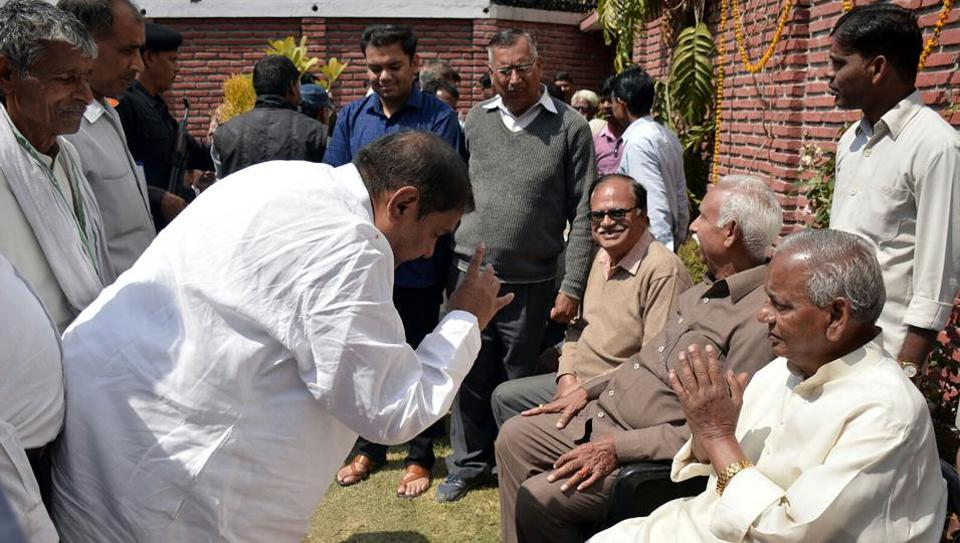 BJPleaders greeting Rajasthan governor Kalyan Singh at his residence in Aligarh after the party's resounding victory in the 2017 assembly elections.