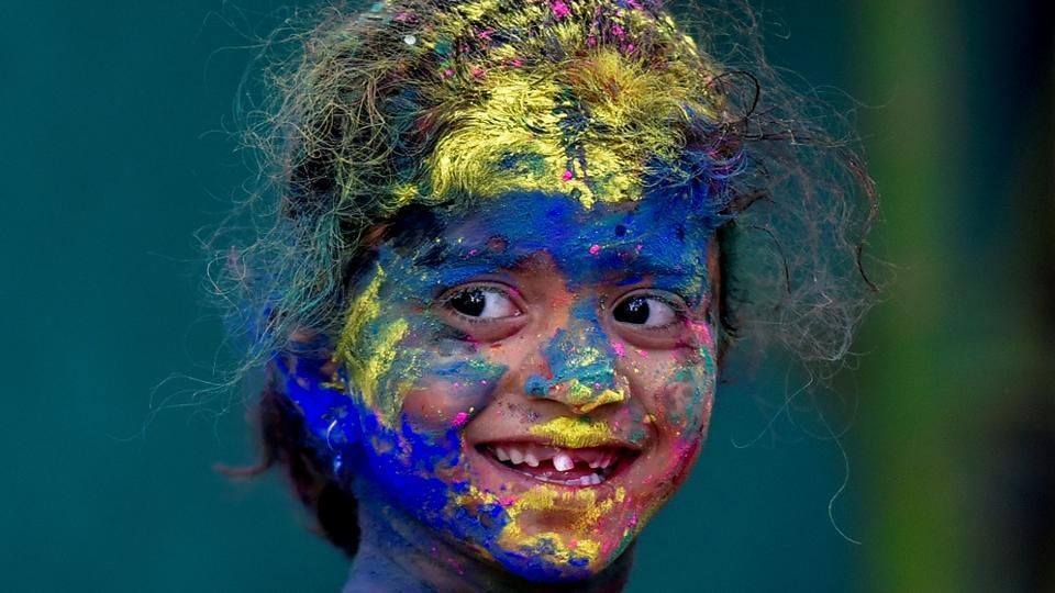A child's smile shines though the colours. (Kunal Patil/HT Photo)