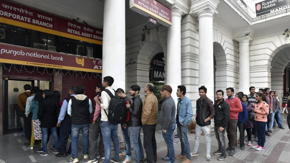 People were seen standing in long queues outside ATMs and banks as currency shortage left little money with the common man for expenses.