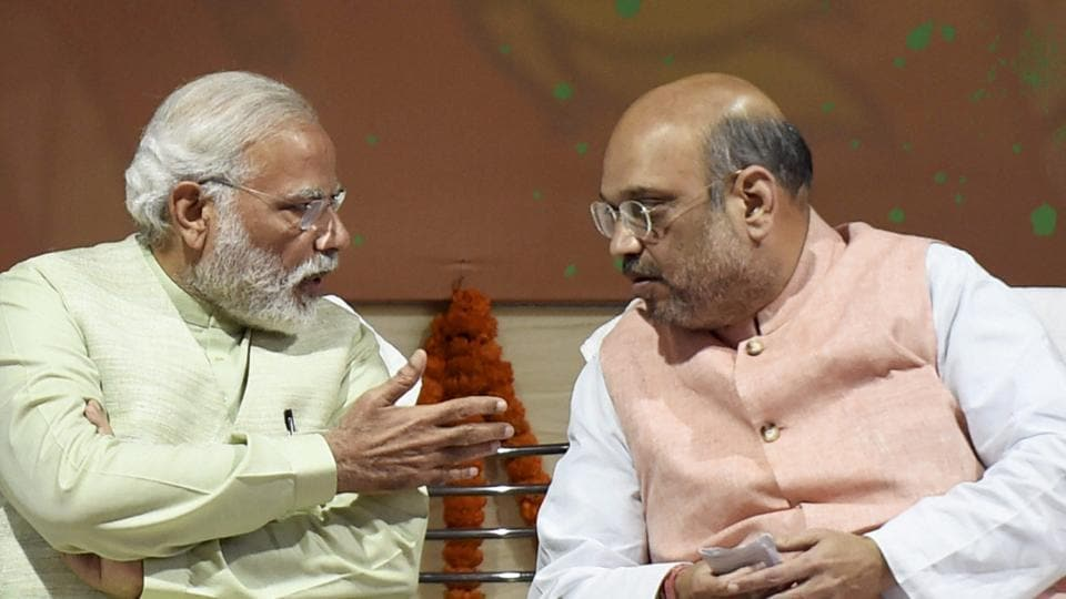 Prime Minister Narendra Modi and BJP president Amit Shah at the party headquarters to celebrate victory in UP and Uttarakhand Assembly elections, in New Delhi on Sunday.