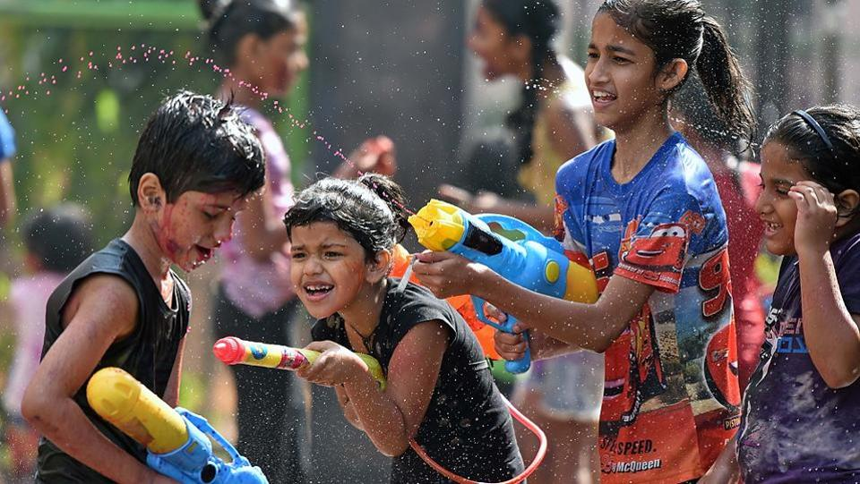It's time to attack, but only with water, for this group in Goregaon on Monday. (Pratham Gokhale/HT Photo)