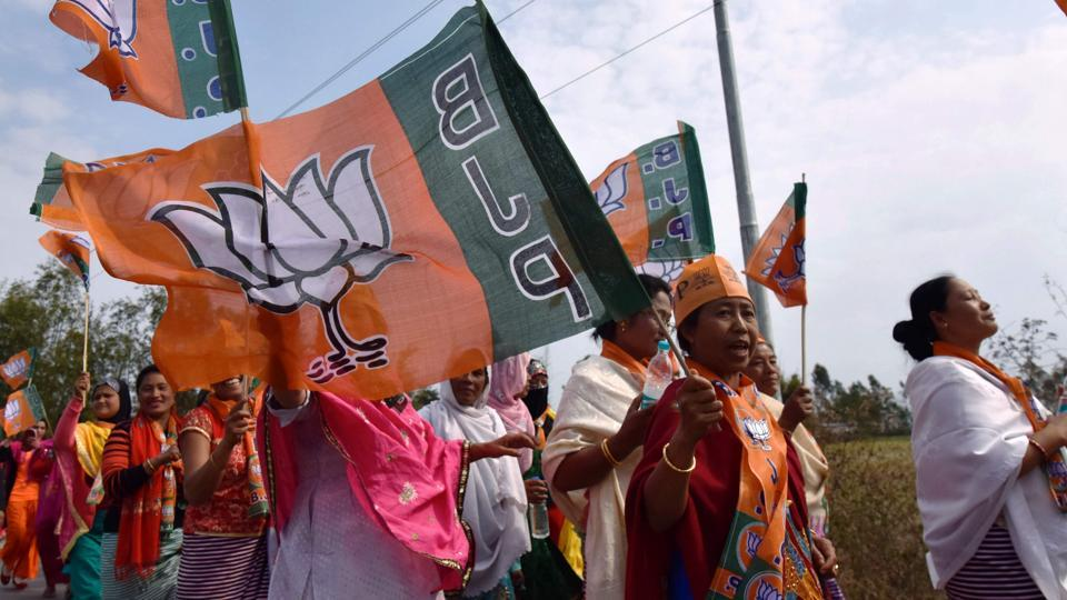 In this photograph taken on March 6, supporters of the Bharatiya Janata Party participate in an election procession in Manipur.