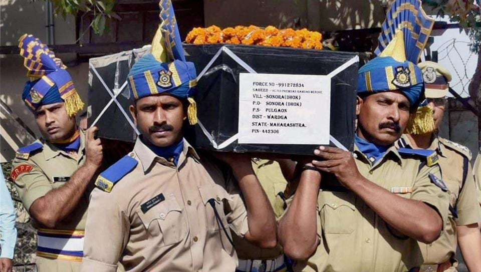 CRPF jawans carry the coffin of HC Premdas Mendhe, killed in an ambush by Maoists in Sukma district of Chhattisgarh, at Nagpur Airport on Sunday.