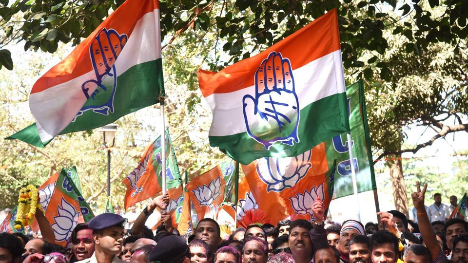 Supporters of the Congress celebrate outside a counting centre in Panaji on March 11.