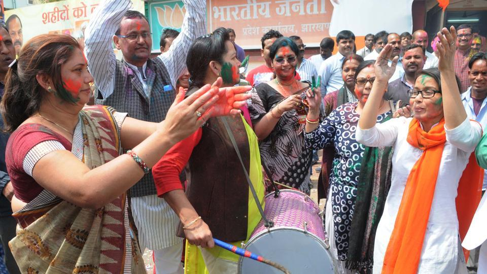 BJP workers celebrating their parties victory in the UP assembly election before the Jharkhand BJP head office in Ranchi