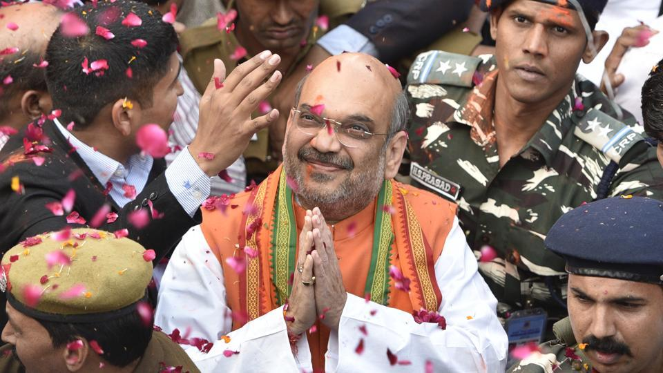 NBJP president Amit Shah greet the supporters and party workers after election results, in New Delhi, India, on Saturday, March 11, 2017.