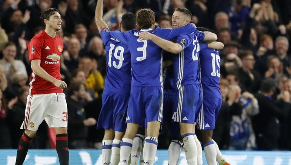 Chelsea FC players celebrate after scoring a goal against Manchester United FC in FA Cup quarter-finals.