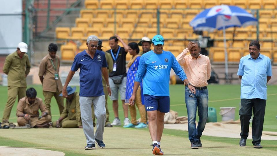 India's cricket coach, Anil Kumble (centre) inspects the M Chinnaswamy Stadium pitch ahead of the second Test against Australia. ICC match rferee, Chris Broad, ruled the pitch 'below average' due to uneven bounce after the match ended in four days.