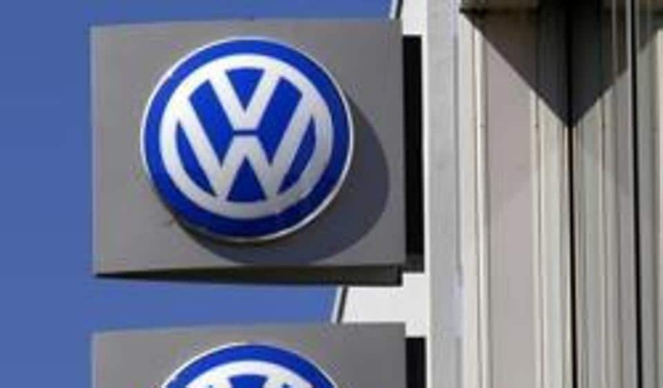 File photo of Volkswagen logos adorning a sign outside a dealership for the German automaker.