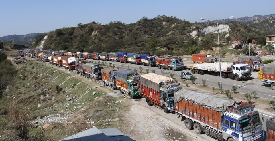 Stranded trucks on the Jammu-Srinagar National Highway that remained closed following landslides.