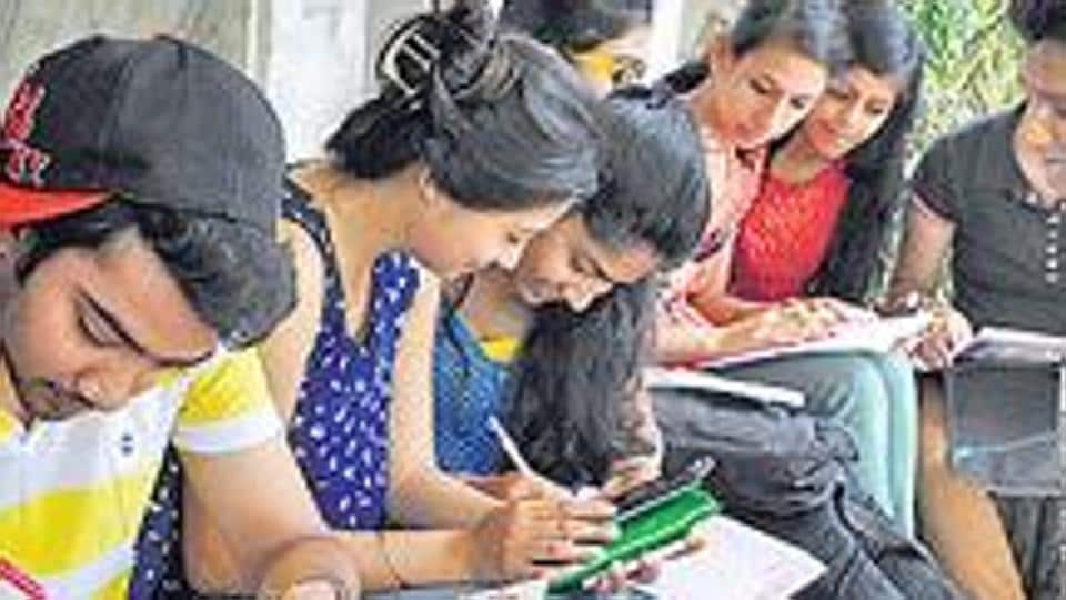 Students registering for engineering entrance exam at an institute.