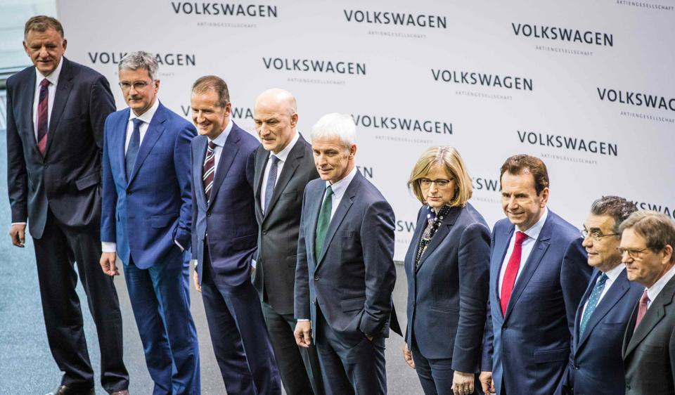 The board of German car maker Volkswagen (from L) Andreas Renschler, Rupert Stadler, Herbert Diess, Frank Witter, CEO Matthias Mueller, Hiltrud Dorothea Werner, Karlheinz Blessing, Francisco Javier Garcia Sanz and Jochem Heizmann pose for a picture prior to the Volkswagen annual media and investor conference at the auto manufacturers head quarters in Wolfsburg on Tuesday.