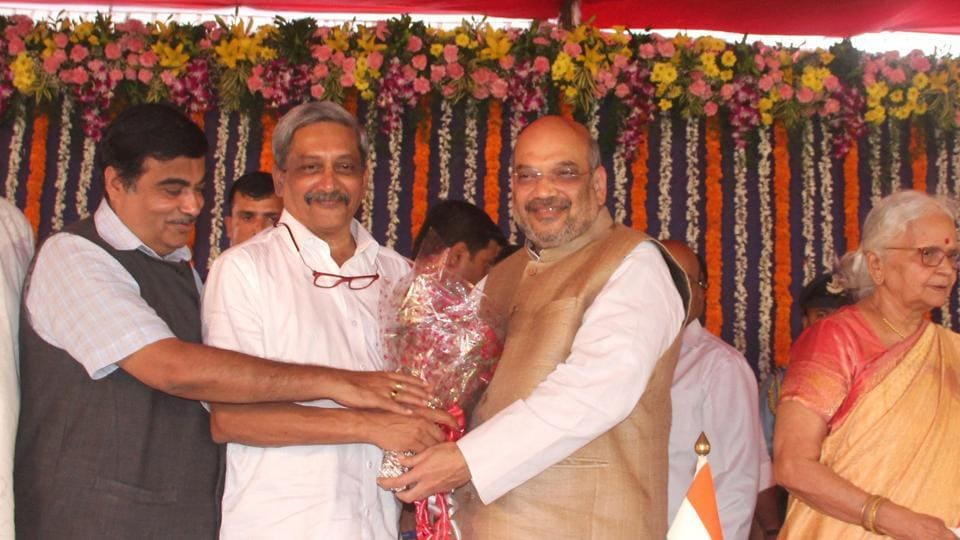 BJP President Amit Shah (Right)  greeting newly sworn- in Goa CM Manohar Parrikar, Tuesday, March 14, 2017. Also seen in the picture are  (L to R)  Union minister Nitin Gadkari and Governor Mridula Sinha.