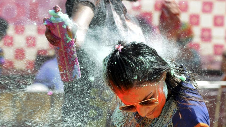 People celebrated Holi in DLF Phase 2 on Monday.