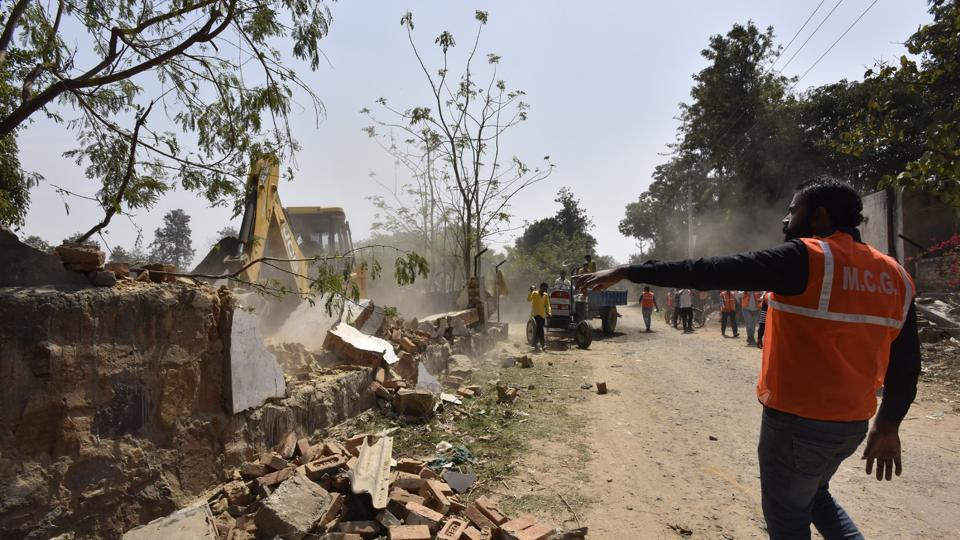 In a six-hour drive, MCG enforcement teams demolished some structures while taking possession of the disputed land at Gwal Pahari on Tuesday.