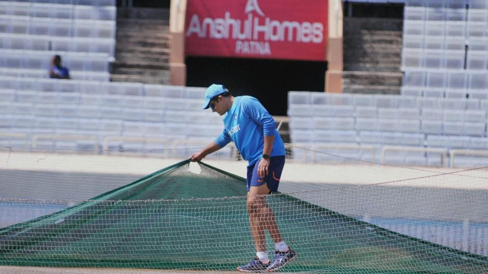 Indian cricket team coach Anil Kumble has a look at the pitch ahead of the warm-up session. (PTI)