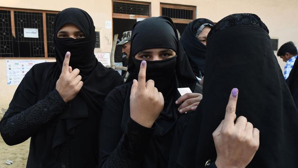 Muslim women show the ink mark on their fingers after voting in the Uttar Pradesh election in Muzaffarnagar.