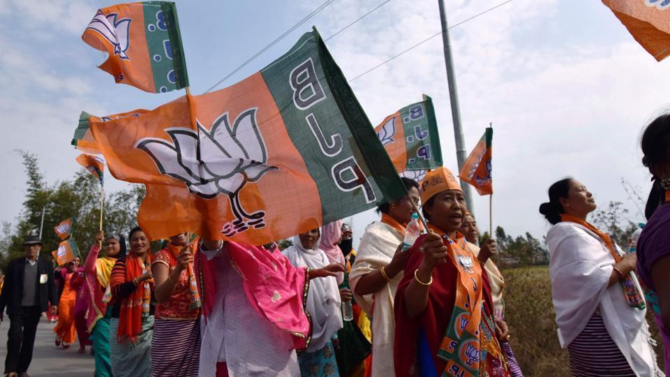 BJP supporters carry out a procession on the final day of election campaigning in the Manipur assembly election.