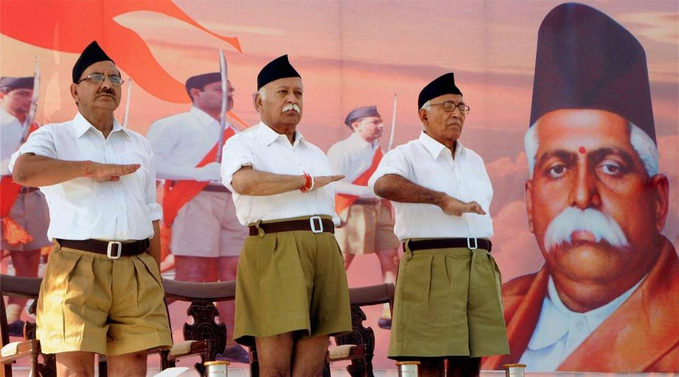 File photo of RSS Chief Mohan Bhagwat (C) .  The RSS has become increasingly assertive it the field of education with many people with open affiliations to the organisation securing top academic jobs.