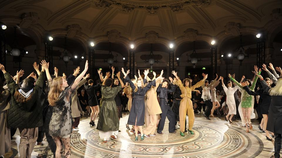 Models dance on the runway at the Stella McCartney Autumn/Winter 2017 fashion show during Paris Fashion Week.