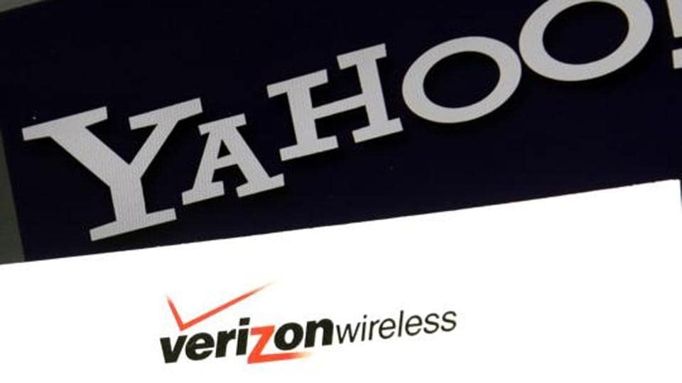 The file photo shows the Yahoo and Verizon logos on a laptop. Yahoo said today that board member and former internet executive Thomas McInerney would lead the business that remains after the sale of its core assets to Verizon is completed.