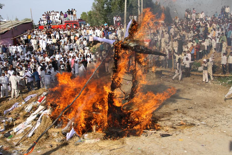 Jat protesters burning an effigy of CM Manohar Lal Khattar in Rohtak's Jassia village on Sunday.