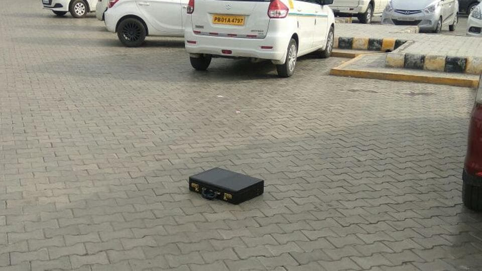 The abandoned suitcase in the parking lot of the Amritsar airport on Wednesday.