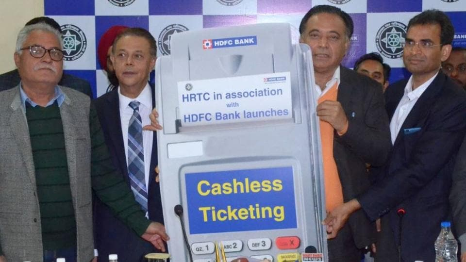 Himachal Pradesh transport minister GS Bali (second from right) during the cashless ticketing system launch event at Dharamshala on Wednesday.
