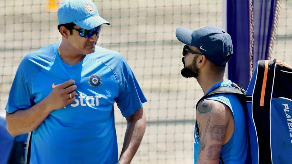 India coach Anil Kumble interacts with skipper Virat Kohli at a practice session before the third Test match against Australia in Ranchi on Wednesday. Live cricket score and live streaming of India vs Australia third Test will be available online.