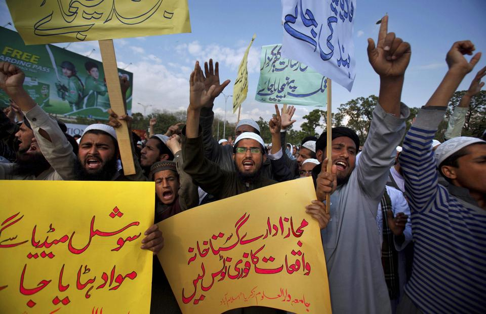 Students of Islamic seminaries chant slogans during a rally in support of blasphemy laws in Islamabad.