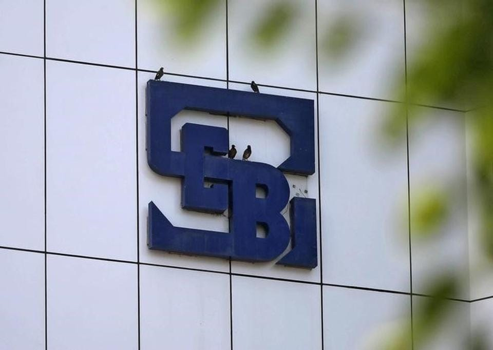 Birds rest on the logo of the Securities and Exchange Board of India (SEBI), India's market regulator, installed on the facade of its head office building in Mumbai