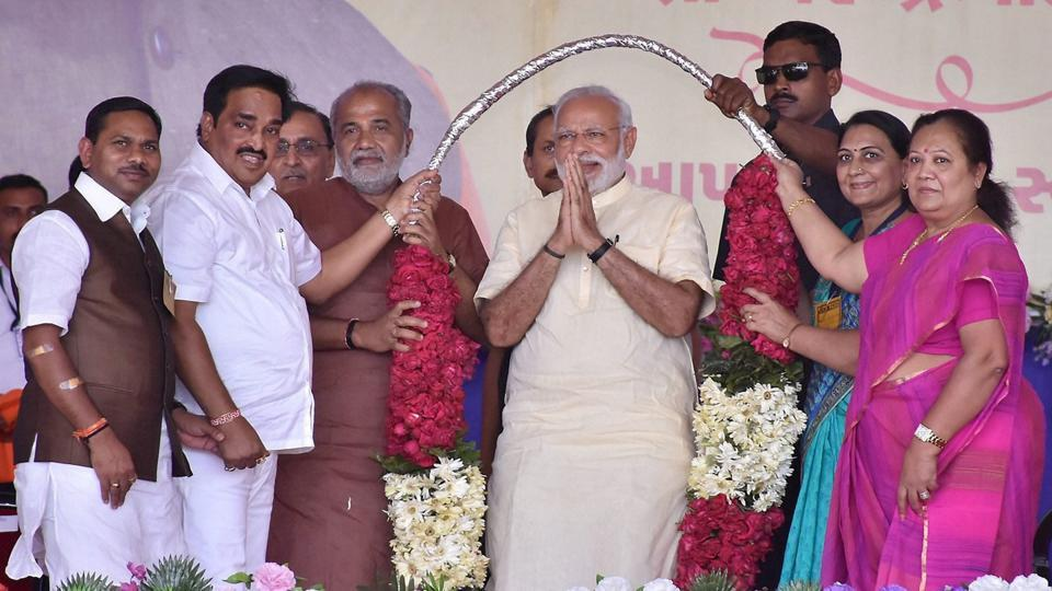 BJP workers welcome Prime Minister Narendra Modi at Surat airport on March 7, 2017, during his latest visit to home state Gujarat.