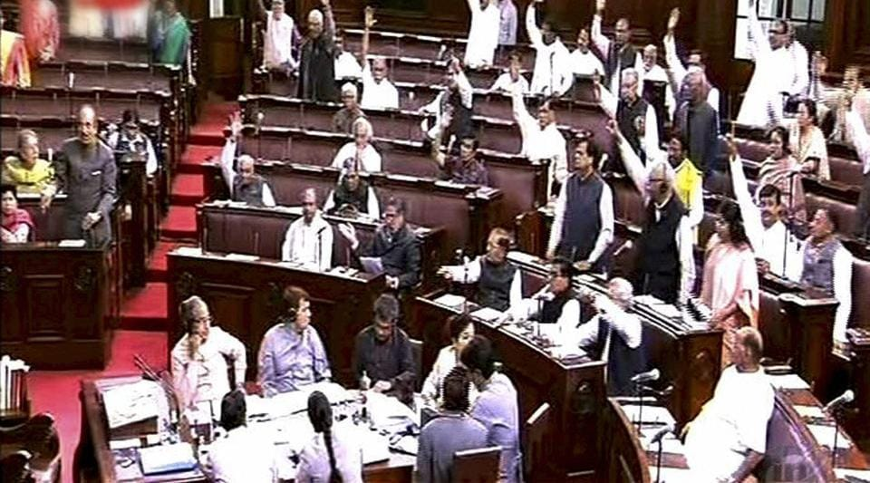 Opposition members protest in the Rajya Sabha in New Delhi on March 15.