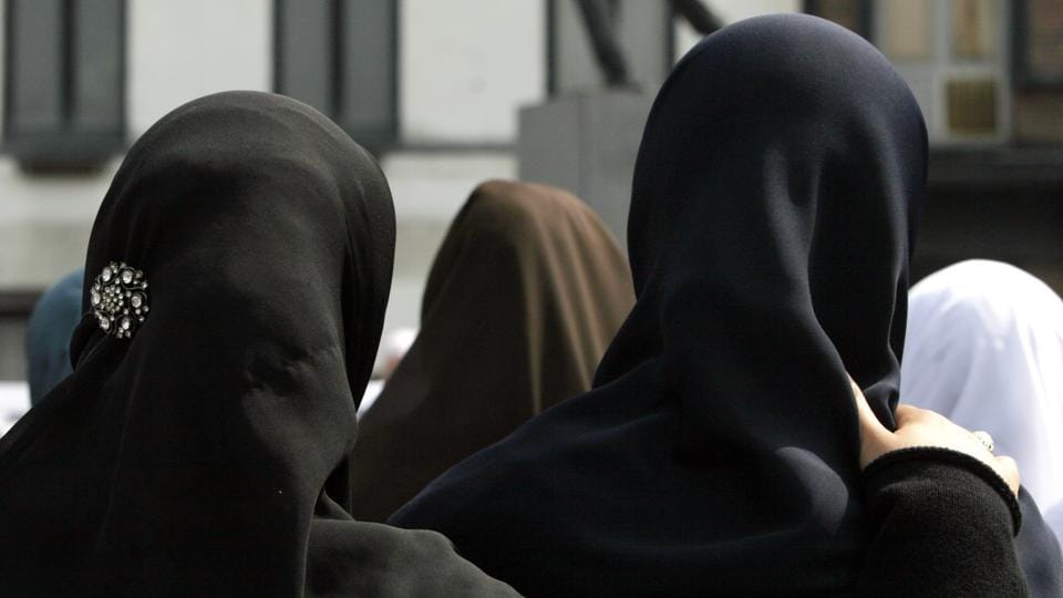 File photo of women gathering for a demonstration in Antwerp, Belgium in June 2009 . Private businesses can forbid Muslim women in their employ from wearing headscarves as long as the ban is part of a policy of neutrality within the company and not a sign of prejudice against a particular religion, the European Court of Justice said on March 14, 2017.