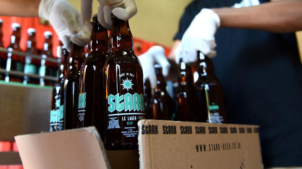 Workers at the Stark beer factory pack bottles of beer.