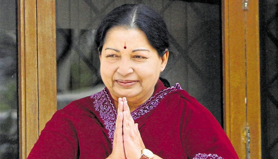 File photo of Jayalalithaa greeting her supporters from the balcony of her residence after an election victory in 2011.