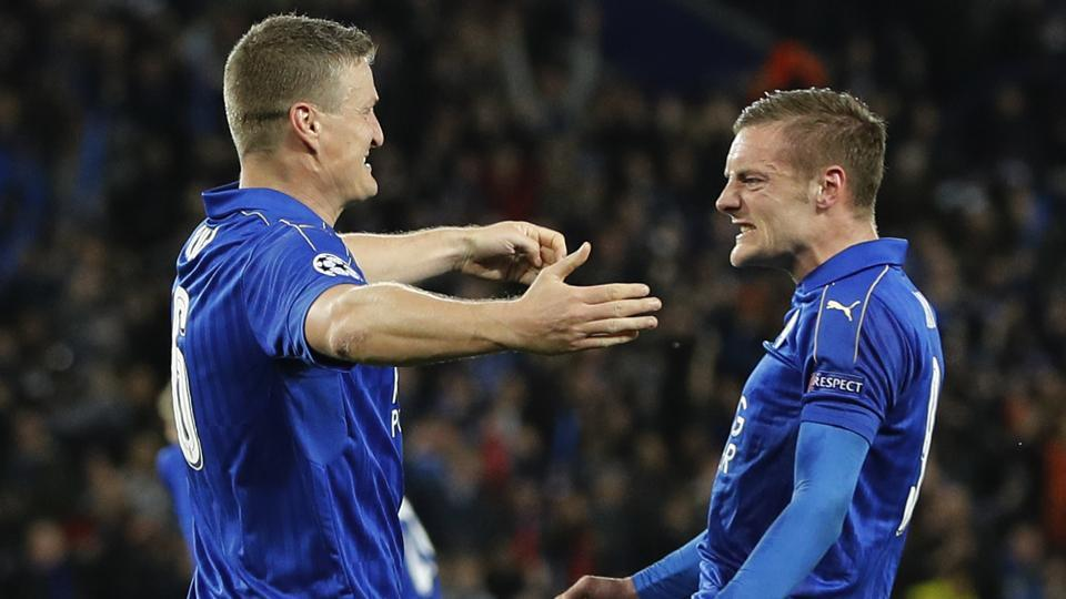 Leicester City's Robert Huth and Jamie Vardy celebrate after Wes Morgan scores their first goal against Sevilla FC in the UEFAChampions League.