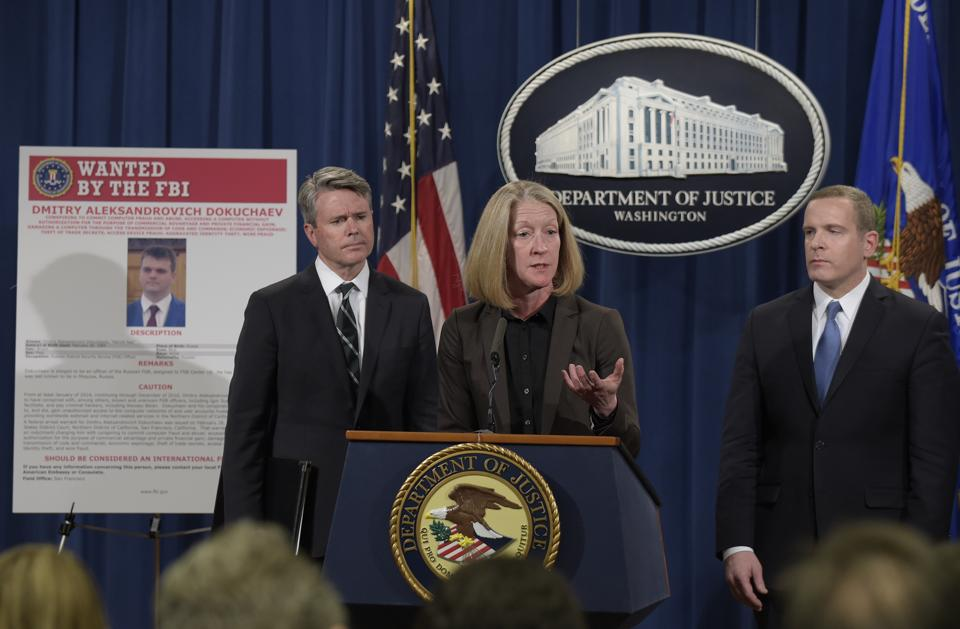 Acting assistant attorney general Mary McCord announces the charges against the four suspects in Washington.