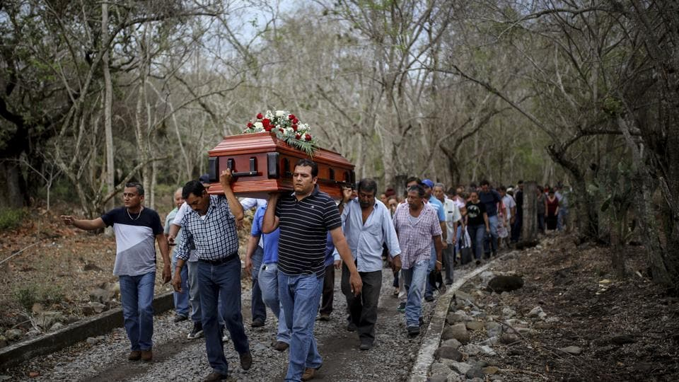 In this March 8, 2017 photo, members of the Solecito search group carry the coffin of Pedro Huesca, a police detective who disappeared in 2013 and was recently found in a mass grave, as they walk to the cemetery in Palmas de Abajo, Veracruz, Mexico. Huesca's remains are part of a collection of more than 250 skulls found over the last several months in what appears to be a drug cartel mass burial ground on the outskirts of the city of Veracruz, prosecutors said Tuesday.