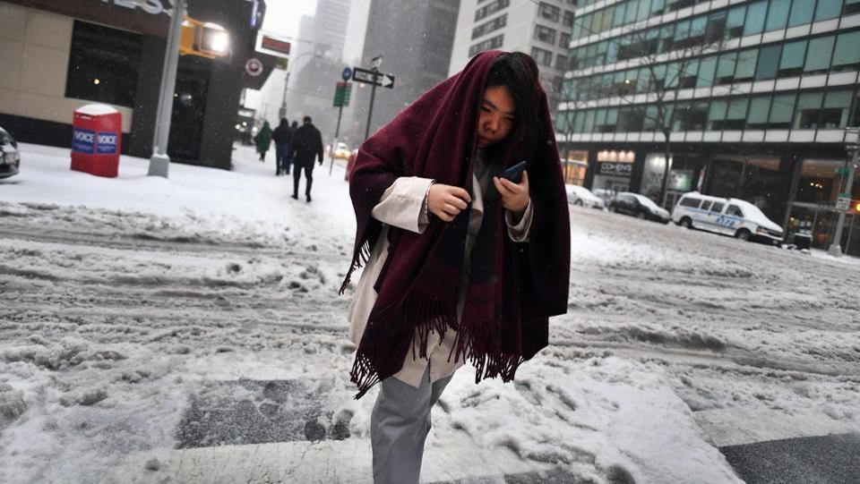 A woman walks on a snow and sleet covered street in New York. Winter Storm Stella unleashed its fury on much of the northeastern United States on March 14 dropping snow and sleet across the region and leading to school closures and thousands of flight cancellations. Stella, the most powerful winter storm of the season, was forecast to dump up to two feet (60 centimetres) of snow in New York and whip the area with combined with winds of up to 60 miles per hour (95 kilometers per hour), causing treacherous whiteout conditions. But after daybreak the National Weather Service (NWS) revised down its predicted snow accumulation for the city of New York, saying that the storm had moved across the coast. (Jewel Samad/AFP)