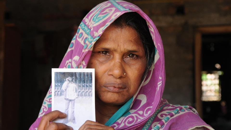 Ashia Bibi holds the picture of her son Imadul who was killed in police firing on March 14, 2007 in Nandigram.