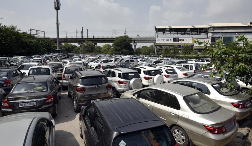 Cars parked at Nehru Place Metro station in New Delhi.